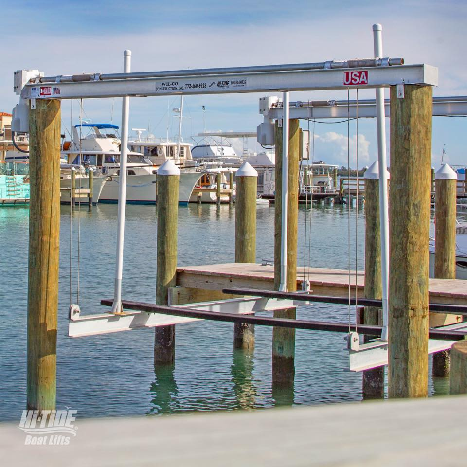 picture of a dock with a boat lift device attached to the beams